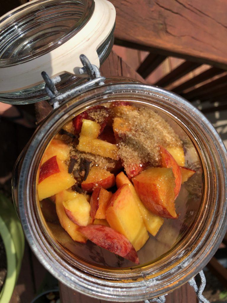 Sugar and peaches for peach infused bourbon